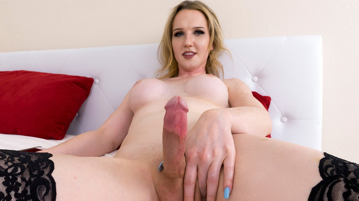 Beautiful shemale playing with big dick 4